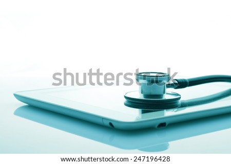 stethoscope and tablet - stock photo