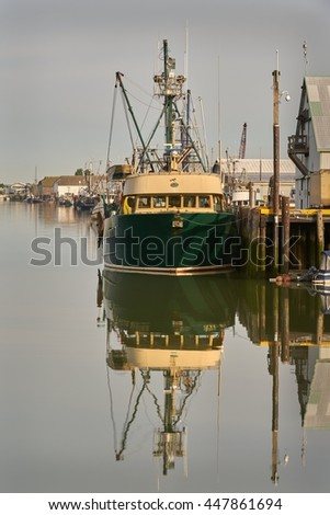 Steveston Fishboat. Boats tied up and in Steveston's harbour. A small fishing village on the banks of the Fraser River near Vancouver, British Columbia, Canada.                             - stock photo