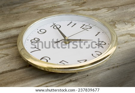 Still Life clock on wood Background