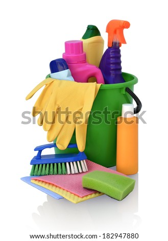 Still life of assortment of various bright detergents for cleaning in green pail isolated on white background - stock photo