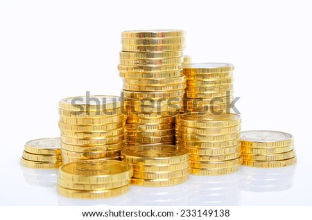 Still life of yellow shiny coins on a white background. - stock photo