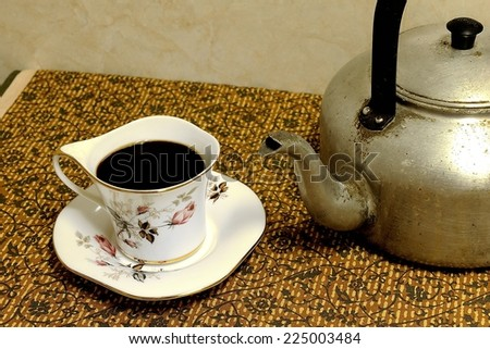 Still life old aluminium kettle on the table - stock photo