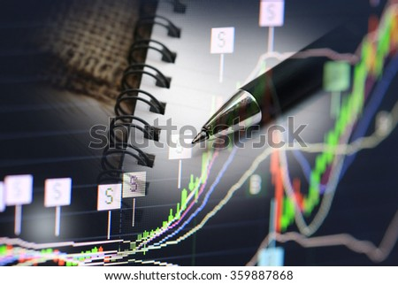 stock chart growing up with money and pen, business and economic news background.