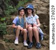 """STOCK - Portrait of two young girls sitting on rocks, Kauai, Molokai, Hawaii, February 2004 (Keith Levit)"" - stock photo"