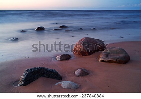 stone on the beach in the evening