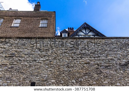 Stone walls at Tower of London historic castle on the north bank of the River Thames - a popular tourist attraction - stock photo