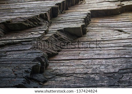 Strata, slate or shale rock layers. - stock photo