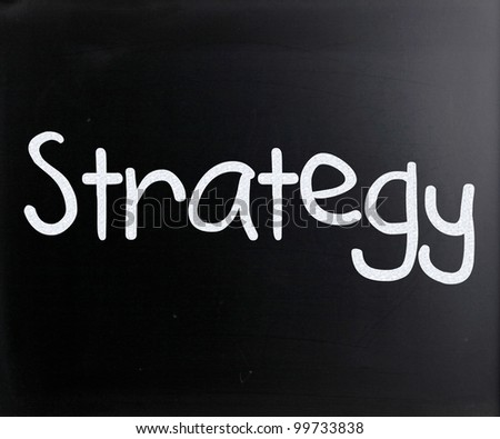 """Strategy"" handwritten with white chalk on a blackboard - stock photo"