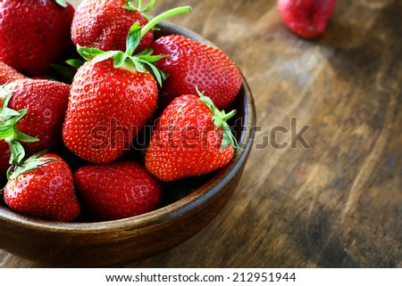 strawberries closeup in wooden bowl, food