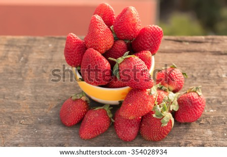 strawberries fresh  In cup placed on a wooden floor,goods strawberries,strawberries,red strawberries - stock photo