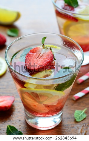 Strawberry and lemon cold drink with mint, selective focus - stock photo