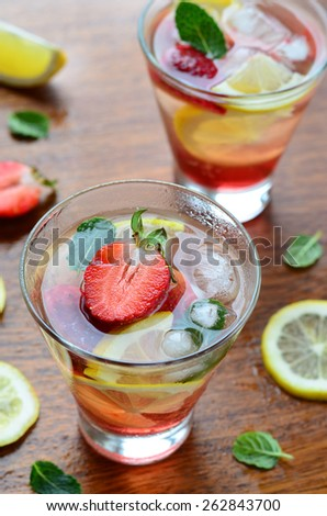 Strawberry and lemon drink, selective focus, vertical - stock photo