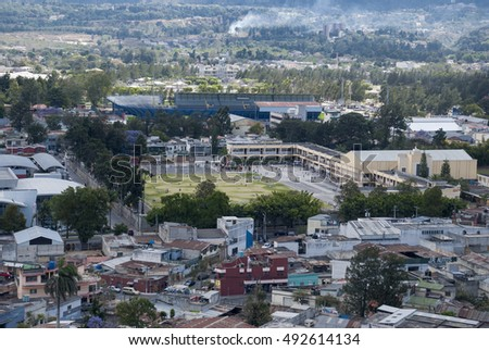 10/03/05. Street view with traffic, city Guatemala mountains. Editorial.