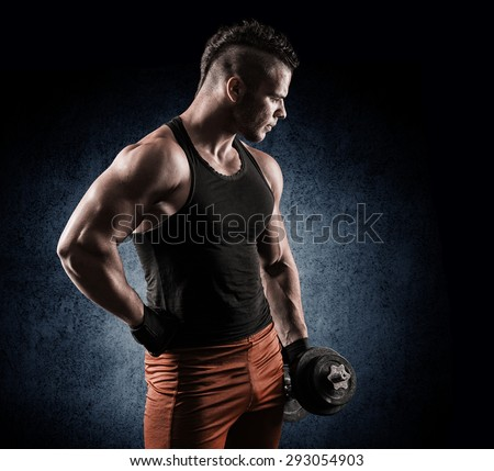 Strong bodybuilder with six pack, perfect abs, shoulders, biceps, triceps and chest. Image with clipping path