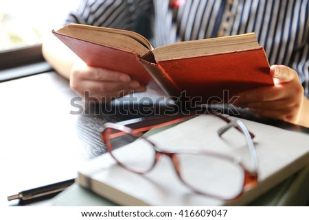student open book and reading,hand writing pen on paper page,hardworking for achievement business target concept, reading book for knowledge concept.