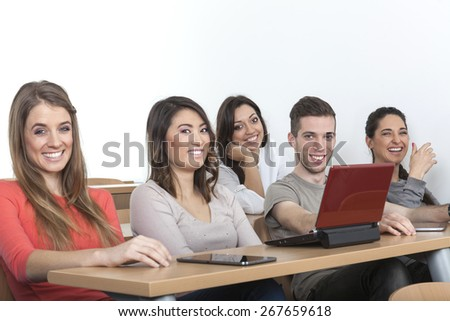 5 students laughing in the lecture hall - stock photo