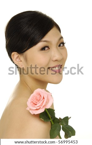 Studio portrait of asian beautiful woman with rose - stock photo