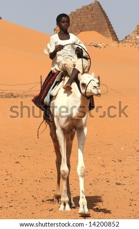 SUDAN - UNKNOWN: A young Sudanese boy sits on a camel in this undated image taken in the Republic of Sudan.