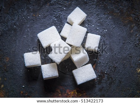 Sugar cubes on a black background