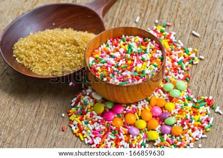 Sugar sprinkles in wood bowls - stock photo
