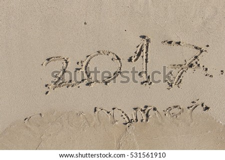"""2017 Summer"" handwritten text on the sands of famous Balos beach in Chania prefecture, Crete Island, Greece."