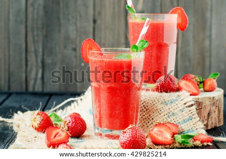 Summer refreshing healthy drink , strawberry smoothie or fresh  with mint on a wooden background - stock photo