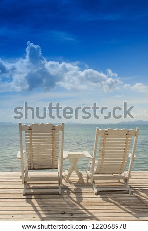 Summer white wood  beach chair with blue sky background - stock photo