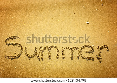 """Summer"" written in the sand on the beach - stock photo"