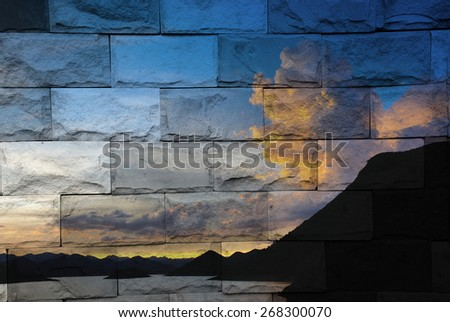 """""""sunset and mountain"""" The brick painting concept. - stock photo"""
