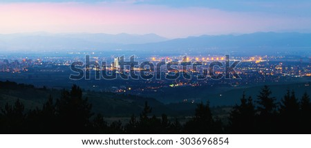 sunset over the city , panorama from mountains near Sofia, Bulgaria - stock photo