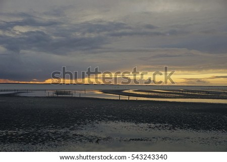 sunset over tidal flats of the Columbia river