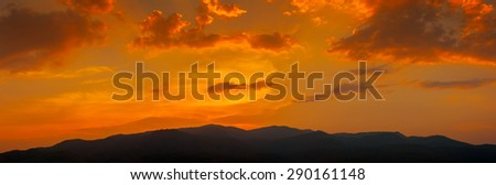 sunset sky over the mountain hills