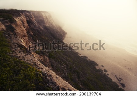sunset view above sea, beach with mountains in the background, - stock photo