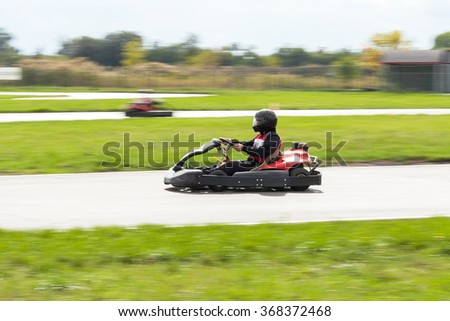 Super kart racing team. Races on cars. Carting. Cars races. Races on a cross-country terrain. Cars races. Races on long exposure. The car on long exposure. - stock photo