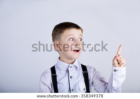 Surprised Pointing little boy isolated over white background. - stock photo