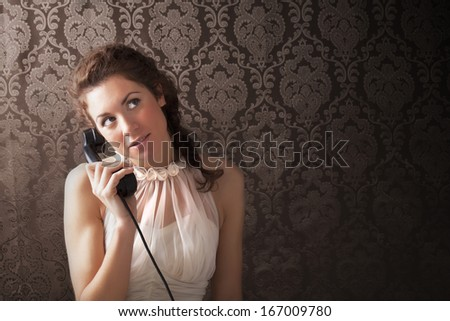 Surprised woman on the phone - stock photo