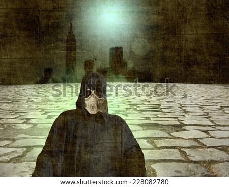 Survivor in gas mask with far city skyline in the dark                               - stock photo