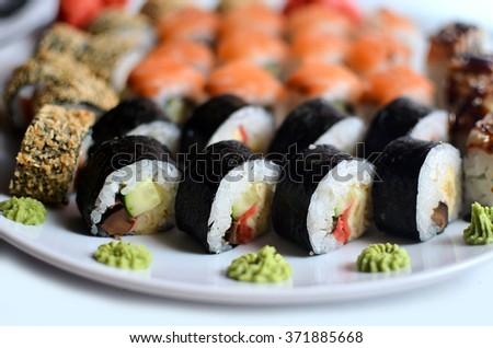 Sushi rolls on a white background - stock photo