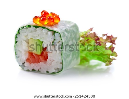 sushi with red caviar , avocado and salmon on a white reflexive background - stock photo