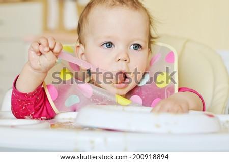 sweet baby girl is eating - stock photo