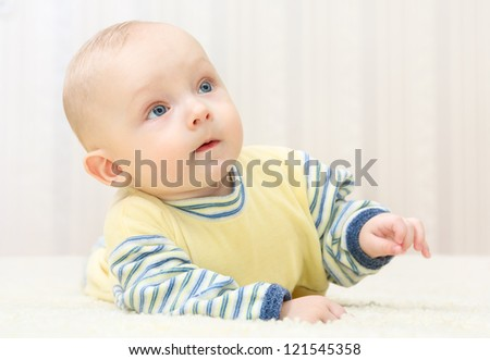 sweet little baby face  looking up at home - stock photo
