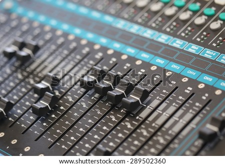 switch, sound controller, mixer board ,Buttons and tabs in various parts of the audio controller mixer ,music, studio,audio sound with buttons and sliders