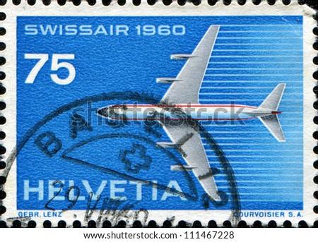 SWITZERLAND - CIRCA 1960: A stamp printed in Switzerland depicted Swissair, circa 1960 - stock photo