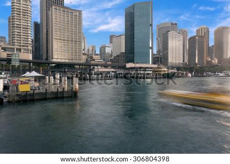 Sydney city buildings in Sydney Harbour - stock photo