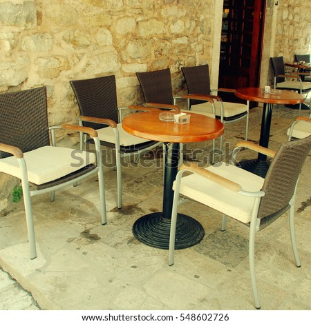 Tables And Chairs On Outdoors Cafe In Mediterranean Europe, Square Vintage  Toned Image