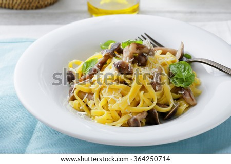 tagliatelle with forest mushrooms, food close-up - stock photo