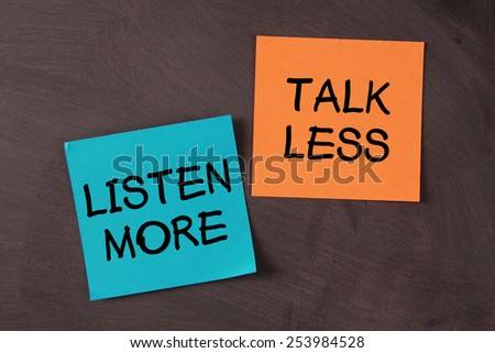 'Talk Less and Listen More' notes pasted on blackboard.