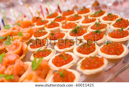 Tartlet with red caviar   . Shallow depth-of-field - stock photo