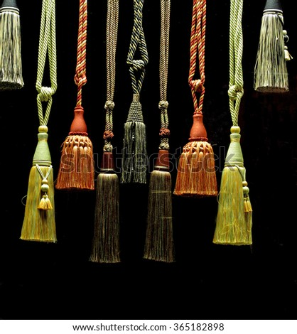 Tassels against a black background - stock photo