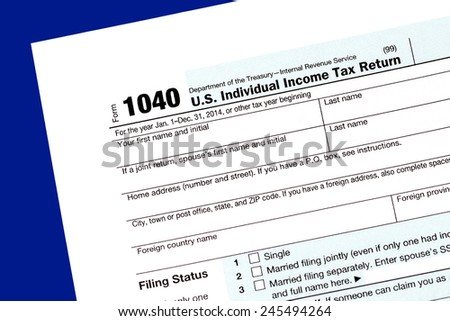1040 Tax Return Form on the Blue Background - stock photo